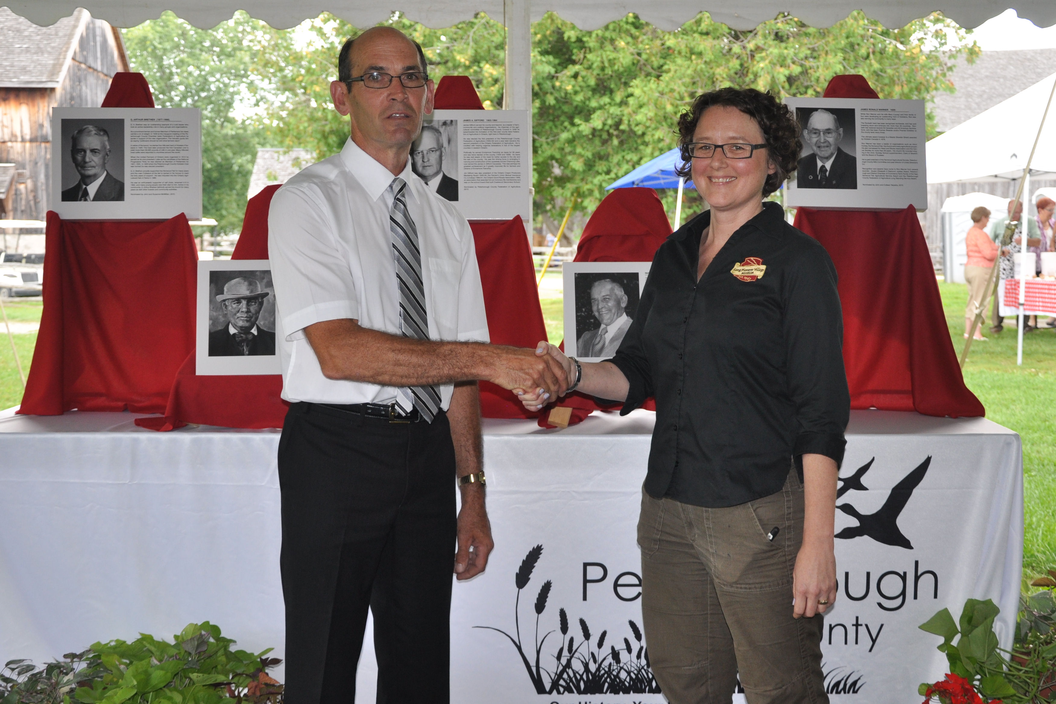 Wayne Warner and Laurie Siblock, Lang Pioneer Village accepting the Inductees