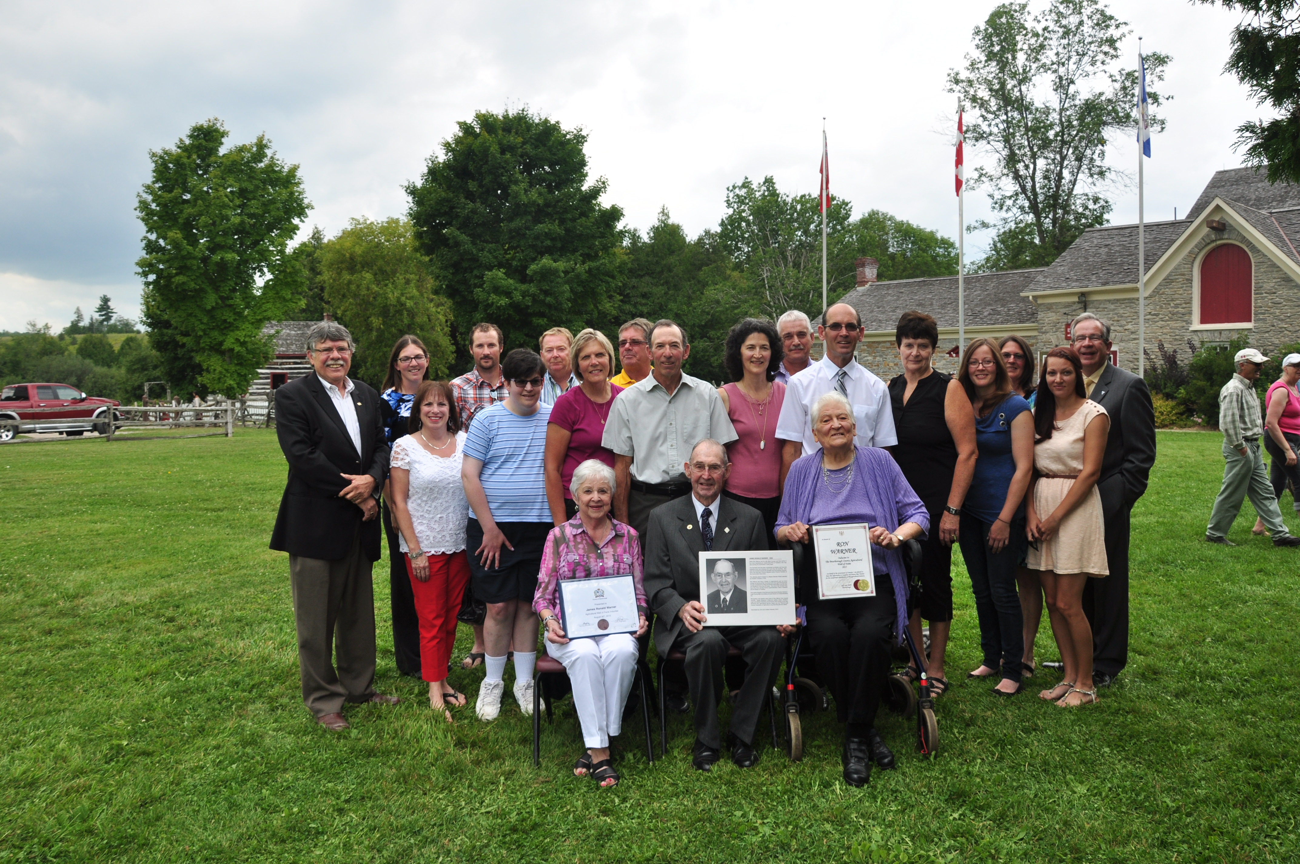 Ron Warner and family with dignitaries